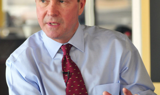 Schuette touts endorsement from official he suspended over alleged scams